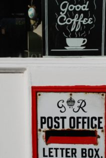 Postbox and coffee sign
