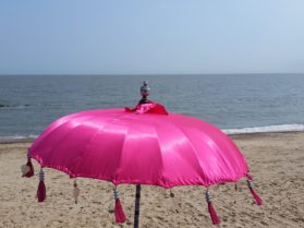 Pink parasol on the beach at Felixstowe